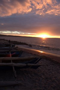 Beached fishing canoes at the end of the day